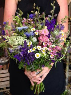 An upright and wild design using meadow flowers, i.e cornflowers, daisies, dill, lavender, larkspur, nigella, mint and wax-flower.