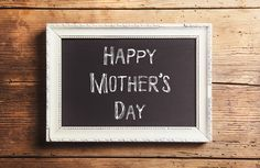Mothers day composition. Picture frame. Wooden background. Studi - Mothers day composition. Chalk sign in picture frame. Studio shot on wooden background.