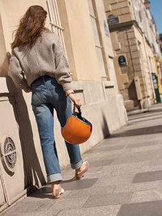 madewell pleat-sleeve pullover sweater worn with the high-rise slim boyjean + leia ballet flat.