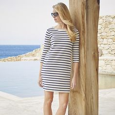 The White Company US. Breton Stripe Shift Dress - White/Navy   With classic binding on the neckline and traditional Breton stripes, this casual cotton shift dress is a true closet hero. The thick ribbed-quality jersey is perfect for the season ahead. Wear this with ankle boots and a leather jacket for a stylish off-duty look. Pinning from the UK? -> http://www.thewhitecompany.com/clothing/new-arrivals/breton-stripe-shift-dress--white/navy/