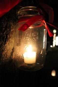 Mason jar, tea light candles, red velvet or tartan ribbon