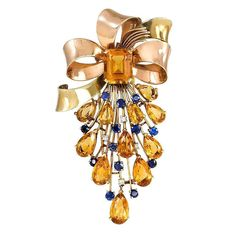 1940s Two-Color Gold, Citrine, Sapphire and Diamond Brooch | From a unique collection of vintage brooches at http://www.1stdibs.com/jewelry/brooches/brooches/