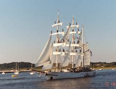 Tarangini three-masted Barque With all hands up on the Yards arm coming out of Muskegon michigan . square rigged on the Fore and Main masts and fore and aft rigged on Mizzen mast.