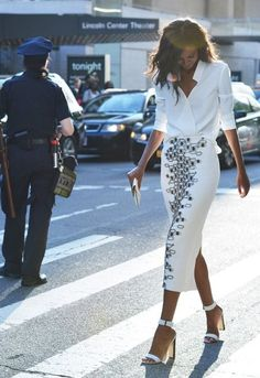 Clean crisp look. White long sleeve blouse, graphic skirt and white heels