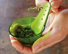 Chef'n ZipStrip Herb Zipper: Just pull the herb stem through the correctly sized hole, and the fresh herbs fall right into the built-in measuring cup! | HellaWella #giftguide #gifts