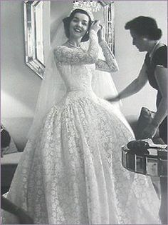 An all important last minute check. 1950s wedding dress. Love the ...