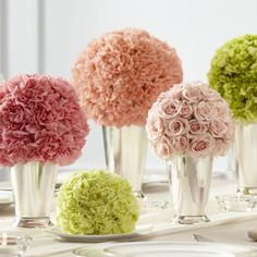 Pastel floral sphere centrepieces for wedding tables.