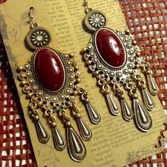 Bohemian Burgundy Earrings These gorgeous earrings features burgundy cabochons set on a dark gold chandelier setting. Truly unique and sturdy metal. Measures 3 inches long. One inch wide. (This closet does not trade or use PayPal ) Jewelry Earrings
