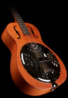 Dobro Hound Dog Round Neck Guitar. No idea how it sounds but looks cool. I can dream!