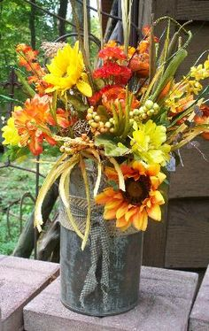 Large ice cream can/fall flowers  $32