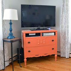 Turning an old dresser from craigslist into a colorful TV stand for our living room with some paint, elbow grease, and a little creativity.