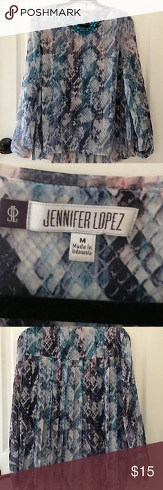 JENNIFER LOOEZ PLEAT BACK BLOUSE IN MEDIUM Stunning in lilac, purples and teal this blouse with its pleated back will make any outfit complete , never worn SALE!! $10!!! Jennifer Lopez Tops Blouses