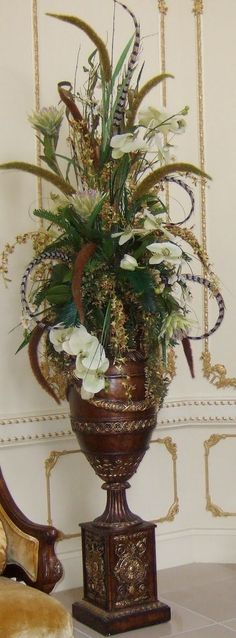 Simply Southern Flowers: large silk flower arrangement, around 28 inches tall, designed flat across the back so it could be used on a fireplace mantel or on an entry hall table. Description from pinterest.com. I searched for this on bing.com/images