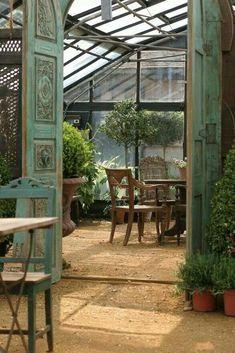 Carved wooden doors opening to a greenhouse / solarium / outdoor / garden space. Outdoor Rooms, Outdoor Gardens, Outdoor Living, Indoor Outdoor, Outdoor Trees, Small Gardens, Garden Cottage, Home And Garden, Inside Garden