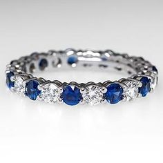 Anniversary Rings Tiffany & Co Shared Setting Band Ring Diamond & Sapphire Eternity Platinum - I think I need this as a mother/son ring since these are Eternity Ring Diamond, Eternity Bands, Diamond Bands, Diamond Jewelry, Sapphire And Diamond Band, Peach Sapphire, Blue Topaz, Sons Rings, Mother Rings