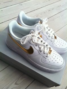 Gold swoosh nike airforce 1