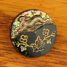Antique black glass picture button, carnival luster. Rabbit !