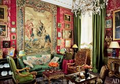 A Gobelins tapestry made for Louis XIV dominates the salon of design consultant Charlie Garnett and antiques dealer Sylvain Lévy-Alban's Paris apartment.