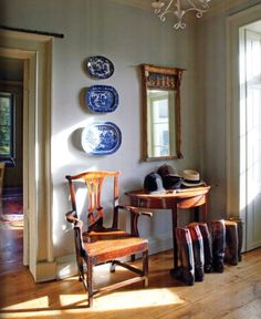 Classic entry grouping in an English home - table, mirror, seating