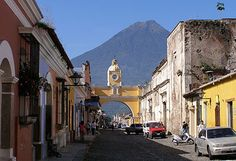 Antigua, Guatemala.  If you like beautiful scenery, architecture, people, coffee, and textiles, go here.  Also known to have crazy New Year's Eve celebrations.