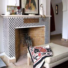 Black and white stenciling on a fireplace surround in Marrakesh. Furniture Stencils | Moroccan Arches Stencil | Royal Design Studio