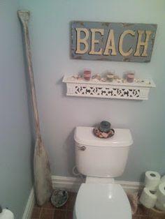 beach themed bathroom decor with an oar