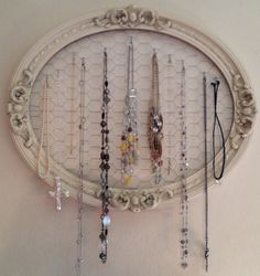 Make a necklace holder from chicken wire stretched behind antique oval picture frame