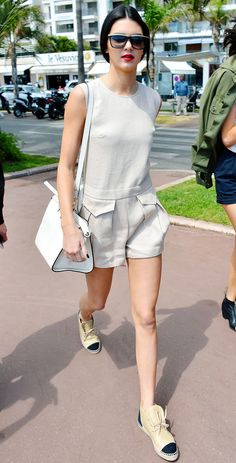 Kendall Jenner pairs a tan linen romper with high top Chanel espadrilles