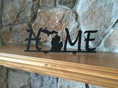 "Metal Shelf Michigan Home Sign Dimensions: 12"" x 4"" x (1"" tabs) Powder Coated Black"