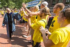 President Schlissel greets students lining the procession route into the ceremony marking his formal installation as UMich's 14th president!