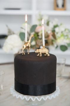 This sophisticated black one with awesome animal toppers. | 24 One-Tier Wedding Cakes That Prove That Less Is More