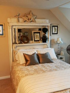 Guest bed headboard using white antique fireplace mantel from Dad's birth home.  Has been repainted white, and antiqued to show age.