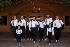 Groomsmen at Villa Siena in black and white with suspenders, bow ties, and Chuck Taylor converse | villasiena.cc