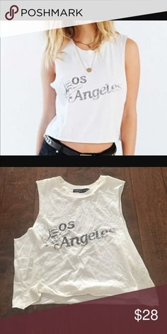 Urban Outfitters Los Angeles Top NWOT Urban Outfitters Los Angeles Top NWOT by future state. Size medium. Sold out! Tag is cut to prevent store return. Super soft material. Cute cut. Urban Outfitters Tops Crop Tops