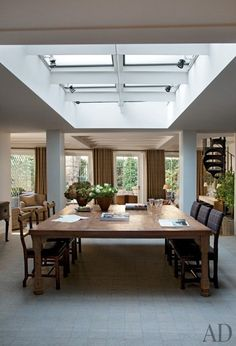 """Architect Lee F. Mindel of Shelton, Mindel & Associates worked with restoration architect Anthony Close-Smith on the extensive project. Mindel recalls, """"We asked ourselves, 'How can we make each room seem spacious and connected to the outdoors?'"""" A large skylight was installed to bring natural illumination to the dining area."""