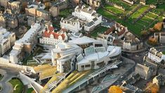 Scottish Parliament - Edinburgh - Built from 1999-2004 & opened by Queen Elizabeth II, the building sits on 4 acres of what was Scottish & Newcastle brewery. The building houses 129 MPs & 1,000 staff & servants.