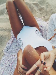 One piece white swimsuit, latest summer trends.