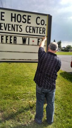 Measuring for our new sign. We offer more than wi fi! Blue Heron Events