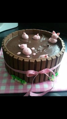 Pig pen cake. This is a great idea and it looks pretty simple. I would make it with chocolate cake and use pink frosting on the inside.