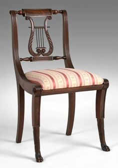 This picture is of a chair with a lyre back. A lyre is a musical intrument of the harp family. It usually has two curved arms connected at the upper end by a crossbar.
