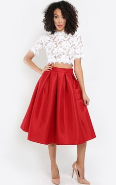 This girl is on fire in this pleated taffeta midi skirt! Looks fierce paired with a white lace crop top! I MakeMeChic.com