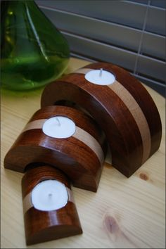 This candleholder set is simply beautiful. We laminated together Cherry and Maple woods creating a solid block of wood. Then cut out each individual piece. Looking at the third picture you can see how we cut the individual pieces from the solid block of wood. Notice how the grains line up. Finally we added a recess for each tea light candle to fit into. It is then finished with a crystal clear gloss lacquer to show off the natural color and characteristics of the wood. $45