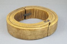 Africa |  Ivory bracelet that has been repaired with metal. ca, prior to 1922 |   Part of the Brooklyn Museum, Museum Expedition 1992 collection.  {unfortunately badly cracked }