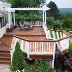This customer wanted the beauty of natural wood without the huge maintenance associated with pressure treated wood. Archadeck designed and built this deck with Ipe (Brazilian Walnut). The railing post and pickets along with the pergola are painted pressure treated wood. The ipe bench and planters really added the attractiveness of this project