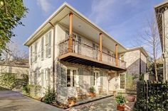 New Orleans-style patio home designed by architect Jon Gilbreath with landscaping & hardscape by Dawson Estes. A private gated drive takes you back to the house and grounds. Gas lanterns flank the Cypress front door. High ceilings and hardwood floors with stately formals, fireplaces and a family room/den off the Island kitchen with a beamed ceiling and patio views and access. Very nice master bedroom, bath and closets. Fourth bedroom with built-ins can be a study. Elevator ready. A p...