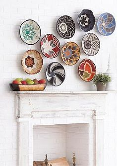 In the same way that you can stack on accessories with an outfit, home accessories are also great for stacking. Show off your collection of quirky plates or baskets on a feature wall in your home.