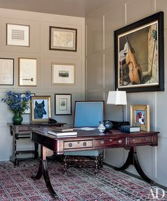 In the study, pet portraits by Mr. Bush join a large work by John Clem Clarke; the Afghan carpet is by Arzu Studio Hope.