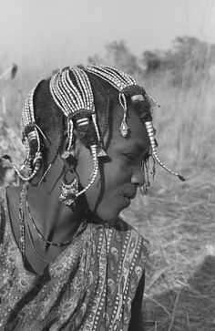 Africa | A young Wodaabe.  Mbere Valley, Adamawa, Northern Cameroon | © Georges Courreges.