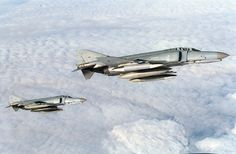 High over Germany a pair of German McDonnell Douglas F-4F Phantoms fly off the left wing of a USAF Boeing KC-135R Stratotanker after receiving fuel. The F-4Fs were from of Jagdgeschwader 74 (JG 74) (74th Fighter Wing) based Neuburg, Bavaria (Germany), and the KC-135R was from the 100th Aerial Refueling Wing, Royal Air Force Mildenhall, UK.