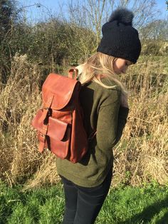 MAHI Leather backpack with double pocket in vintage brown - perfect for a country stroll.